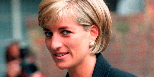 Princess Diana arrives at the Royal Geographical Society in London for a speech on the dangers of landmines throughout the world June 12, 1997. — Reuters
