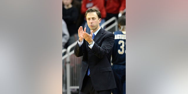 FILE - In this Dec. 19, 2012 file photo, Florida International coach Richard Pitino applauds his team's effort during the second half of an NCAA college basketball game against Louisville in Louisville, Ky. Minnesota is in advanced discussions with Richard Pitino, the son of Louisville coach Rick Pitino, to take over for Tubby Smith. Two people with knowledge of the discussions say Pitino engaged in negotiations with Minnesota officials on Wednesday, April 3, 2013. The people requested anonymity because the deal has not been formally completed. In his lone season at Florida International, Pitino led the Panthers to an 18-14 record, the school's first winning season in 13 years.  (AP Photo/Timothy D. Easley, File)