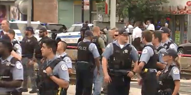 Some protesters jostled with police, who then cordoned off the area on Saturday, July 14, 2018.