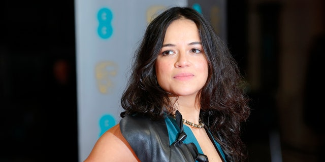 Michelle Rodriguez arrives at the British Academy of Film and Arts (BAFTA) awards ceremony at the Royal Opera House in London February 16, 2014. REUTERS/Suzanne Plunkett (BRITAIN - Tags: ENTERTAINMENT HEADSHOT) - RTX18YDX