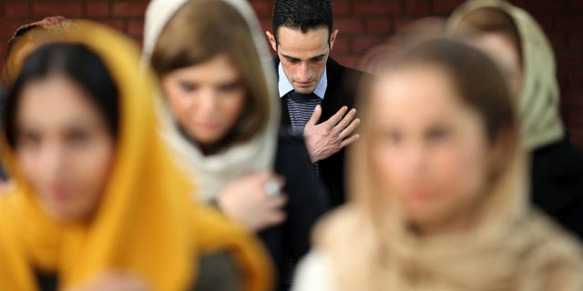 Monday, Dec. 24, 2012: Iranian Christians pray in the Christmas Mass at the Saint Mary Chaldean- Assyrian Catholic church, in downtown Tehran, Iran.