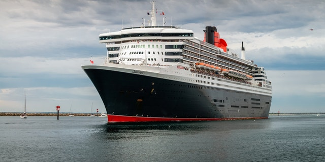 Adelaide, Australia - March 10, 2014: RMS Queen Mary 2 with people on board is leaving for cruise from Outer Harbour in Port Adelaide, South Australia