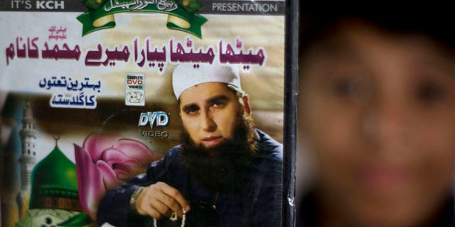 FILE - In this Dec. 3, 3014 file photo, a vendor shows a DVD of Pakistan's Junaid Jamshed at a stall in Islamabad, Pakistan. A plane belonging to Pakistan's national carrier crashed on Wednesday with about 42 passengers and five crew members and an engineer on board, apparently killing all of them, police and an airline spokesman said on Wednesday, Dec. 7, 2016. Authorities have released names of passengers -- among them Junaid Jamshed, a famous singer-turned-Islamic-preacher. (AP Photo/B.K. Bangash, File).