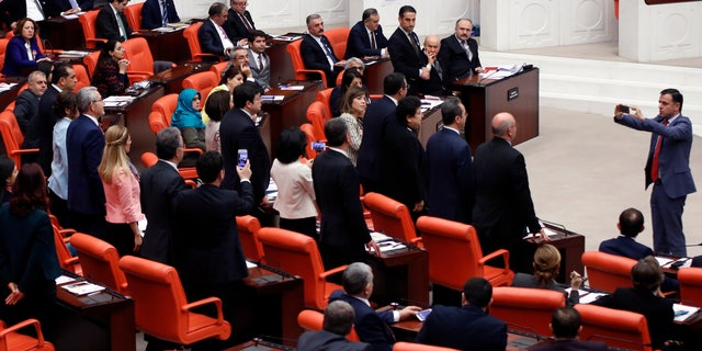 Lawmakers in Turkey's parliament debate amendments to the country's constitution.