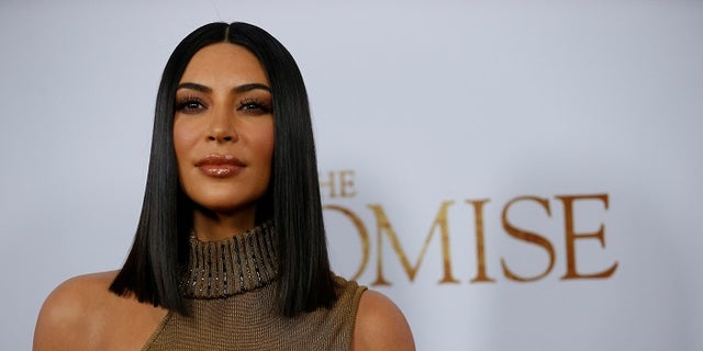 Kim Kardashian is under fire after calling people who didn't recognize her costume the R-word.