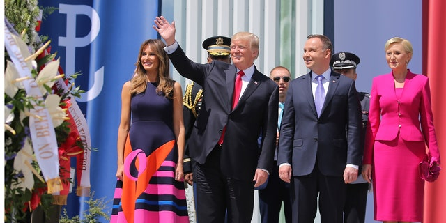 U.S. President Donald Trump waves next to First Lady of the U.S. Melania Trump, Polish President Andrzej Duda and First Lady of Poland Agata Kornhauser-Duda before Trump's public speech at Krasinski Square, in Warsaw, Poland July 6, 2017. REUTERS/Carlos Barria - RTX3AA24