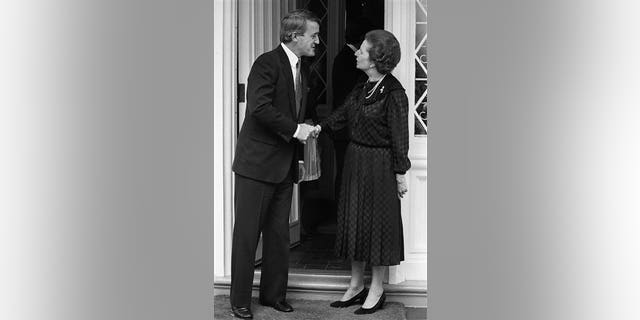 Then opposition leader Brian Mulroney shakes hands with British Prime Minister Margaret Thatcher at the British High Commissioners residence in Ottawa, Ont. Sept. 26, 1983.