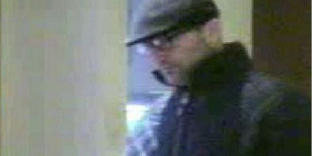 Andrew Robert Levene, seen here in a surveillance image, was charged with the killing of a Connecticut jeweler.