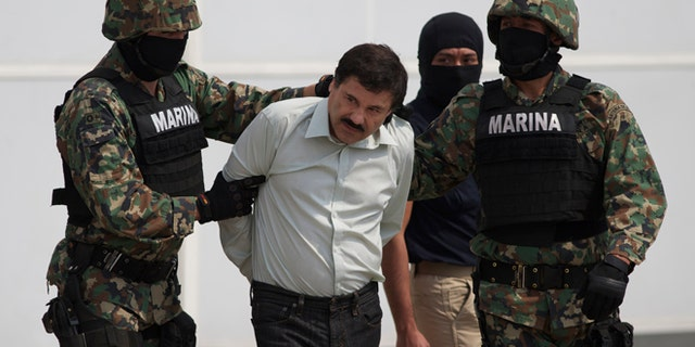 "Joaquin ""El Chapo"" Guzman is escorted to a helicopter in Mexico City, Saturday, Feb. 22, 2014."