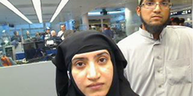 FILE - This July 27, 2014 file photo provided by U.S. Customs and Border Protection shows Tashfeen Malik, left, and Syed Farook, as they passed through O'Hare International Airport in Chicago. (U.S. Customs and Border Protection via AP, File)