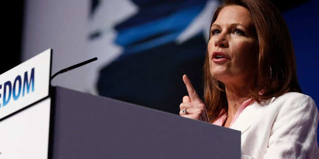 """June 20, 2014: Rep. Michele Bachmann (R-MN) gestures at the second day at the 5th annual Faith & Freedom Coalition's """"Road to Majority"""" Policy Conference in Washington."""