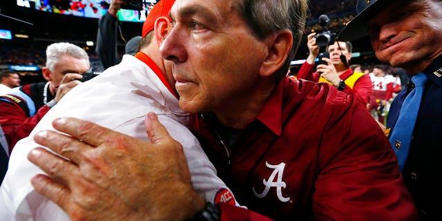 Alabama head coach Nick Saban, right, hugs Clemson head coach Dabo Swinney after the Sugar Bowl game, in New Orleans, Jan. 1, 2018.