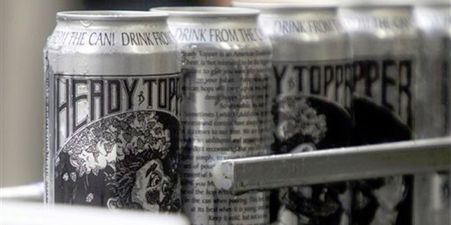 Cans of Heady Topper roll off the line at the Alchemist Cannery in Waterbury, Vt.