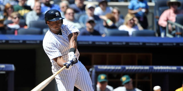 New York Yankees' Chris Nelson bas against the Oakland Athletics during the fourth inning of a baseball game at Yankee Stadium on Saturday, May 4, 2013 in New York. Nelson was acquired from the Colorado Rockies. He struck out in the at-bat. (AP Photo/Kathy Kmonicek)