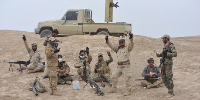 Iraqi soldiers take a break from fighting.