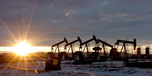Oil derricks at the Bakken shale formation in North Dakota.
