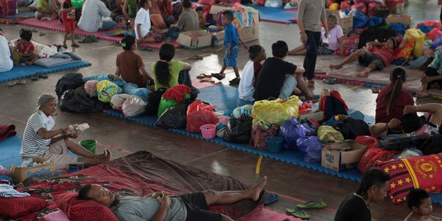 Villagers rest at a temporary evacuation center for people living near Mount Agung, a volcano on the highest alert level, inside a sports arena in Klungkung, on the resort island of Bali, Indonesia, Sept. 28, 2017.