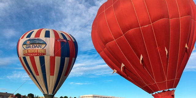 Two hot air balloons inflate at Vista Grande Elementary School in Rio Rancho, N.M. on Friday, Sept. 30, 2016.