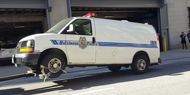 The Baltimore police van Freddie Gray was transported in the day of his arrest and injury is moved to the Courthouse East garage prior to being shown to jurors in the trial of officer William Porter on Thursday, Dec. 3, 2015 in Baltimore.  Jurors did not ask any questions about the van when they inspected it, and were not given any information about it during the viewing, Baltimore Circuit Judge Barry Williams said. Reporters and members of the public were not allowed to witness the jurors' viewing. (Ian Duncan/The Baltimore Sun via AP)  WASHINGTON EXAMINER OUT; MANDATORY CREDIT