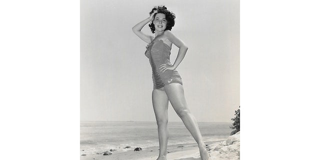 As a starlet in Hollywood in the early 1950s, Anne posed for publicity photos that emphasized her figure.