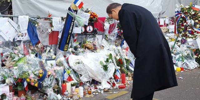 UN General Secretary Ban Ki-moon pays respects at the memorial outside The Bataclan, the music venue where terrorists gunned down scores of patrons on Nov. 13. (Casey Sherman)