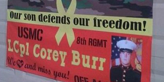 This photo, provided by Jodi Burr, shows the sign supporting their sign's military service. The Burr family says their homeowner's association is suing them for their refusal to take down the banner from their front yard.