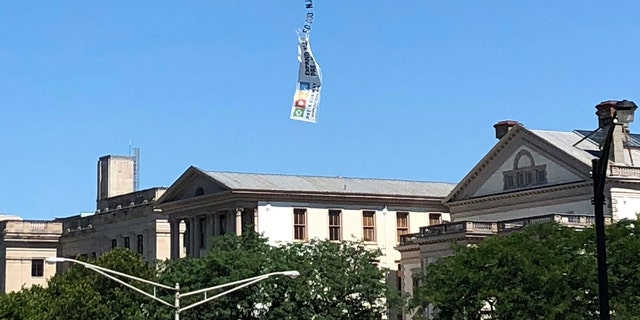 The banner was photographed floating down from the sky after breaking loose from its plane.