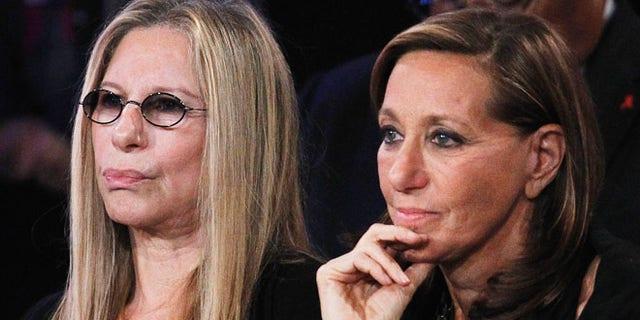 Barbra Streisand and designer Donna Karan at a political event.