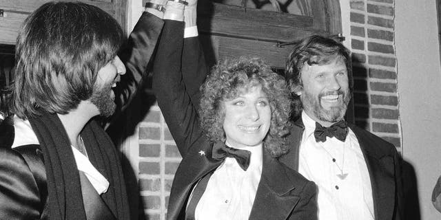 "Here, producer Jon Peters, from left, Barbra Streisand and Kris Kristofferson appear at a preview of the film, ""A Star is Born,"" in New York."