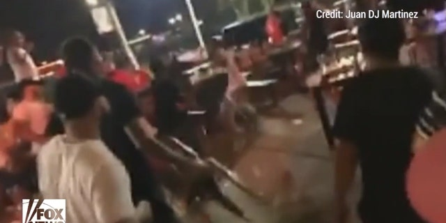Customers could be seen backing away as the brawlers reached for chairs to use as projectiles.