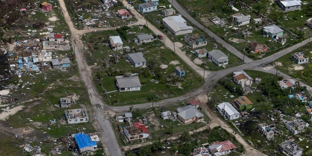 Houses are seen in ruins in Codrington on the island of Barbuda just after a month after Hurricane Irma struck the Caribbean islands of Antigua and Barbuda, October 7, 2017.
