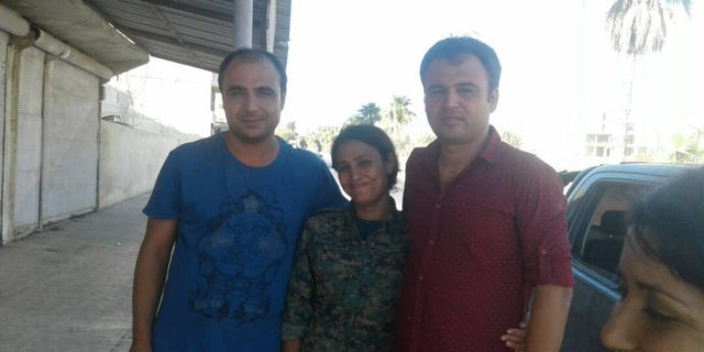 Barin Kobani with her brothers