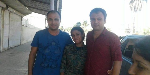 Barin Kobani with her brothers