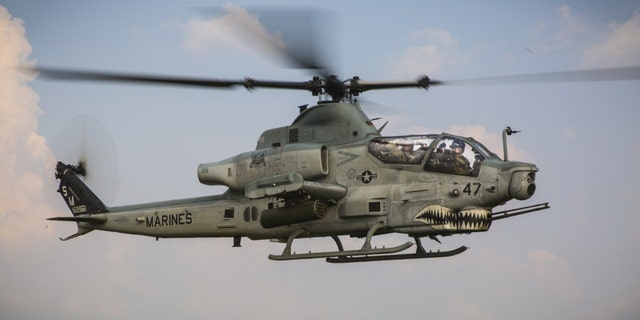 File photo - A U.S. Marine AH-1Z Viper with Marine Light Attack Helicopter Squadron 369 flies alongside a UH-1Y Venom at Ban Chan Khrem, Thailand, Feb. 21, 2018.