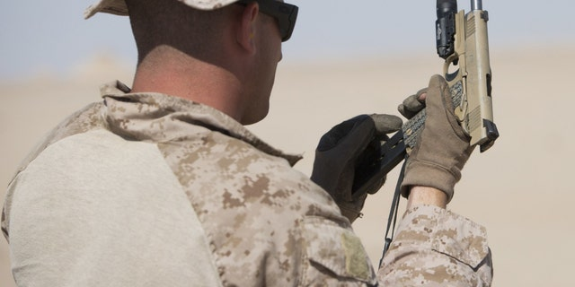 File photo - a U.S. Marine with Force Reconnaissance Platoon, Maritime Raid Force, 26th Marine Expeditionary Unit (MEU), reloads an M1911 during a training exercise Jan. 22, 2016. (U.S. Marine Corps photo by Cpl. Joshua W. Brown/Released)