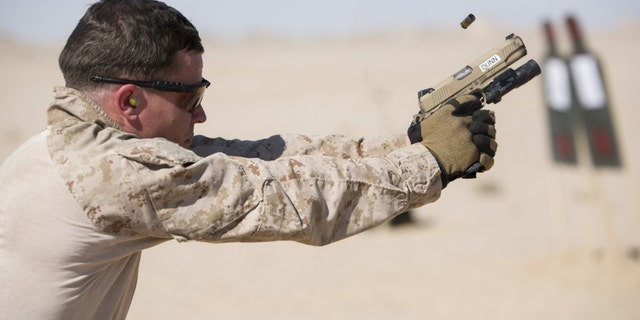 File photo - a U.S. Marine with Force Reconnaissance Platoon, Maritime Raid Force, 26th Marine Expeditionary Unit (MEU), fires an M1911 during a training exercise Jan. 22, 2016. (U.S. Marine Corps photo by Cpl. Joshua W. Brown/Released)