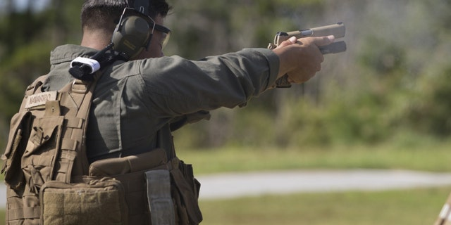 File photo - Lance Cpl. Rober Navarro fires his M1911 during a Special Reaction Team familiarization range Nov. 8, 2017 aboard Camp Hansen, Okinawa, Japan. The M1911 is an issued side arm for SRT Marines, Reconnaissance Marines and Marine Corps Forces Special Operations Command. SRT Marines utilize these familiarization ranges to ensure they are comfortable with their weapon systems under duress. (U.S Marine photo by Lance Corporal Tayler P. Schwamb)