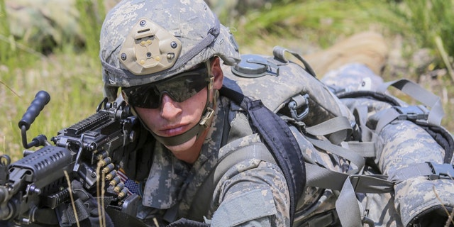 File photo - a U.S. soldier with an M249 SAW (U.S. Army)