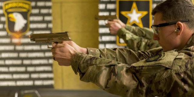 Soldiers use the U.S. Army's new pistol (101st Airborne/U.S. Army)