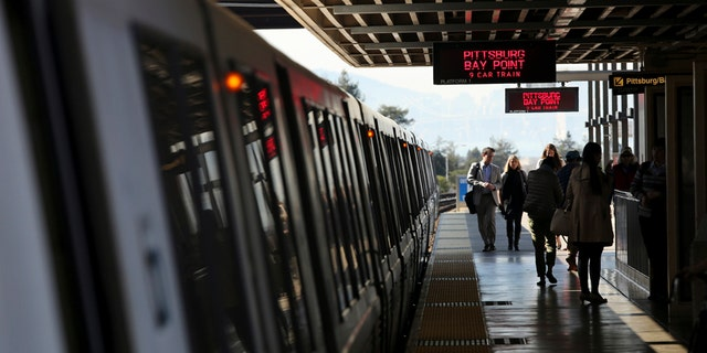 Passengers depart from a Bay Area Rapid Transit (BART) train in Oakland, California.