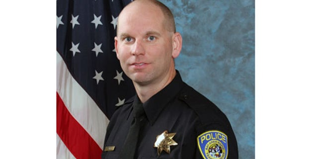 In this undated photo released by Bay Area Rapid Transit shows police Sgt. Tom Smith.