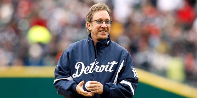 Television comedian Tim Allen stands on the pitchers mound with the ceremonial pitch ball before the start of the Detroit Tigers' MLB American League baseball season home opener against the Cleveland Indians in Detroit, Michigan April 9, 2010.  REUTERS/Rebecca Cook  (UNITED STATES - Tags: SPORT BASEBALL) - RTR2CMKU