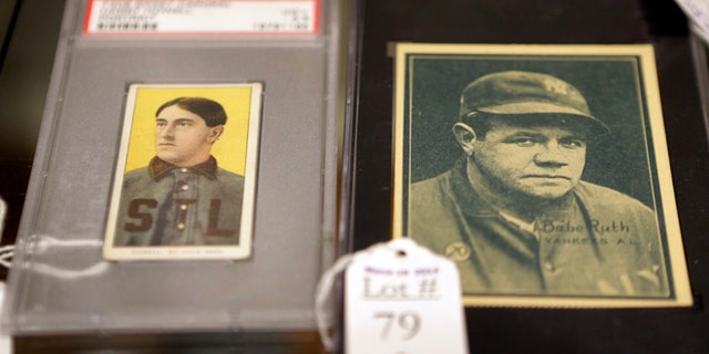 March 11, 2014: Baseball cards of major leaguers Harry Howell, left, and Babe Ruth are seen at the Saco River Auction House in Biddeford, Maine.
