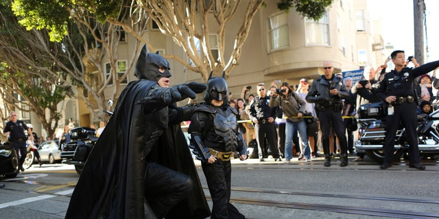 November 15, 2013. Five-year-old leukemia survivor Miles Scott, dressed as Batkid arrives with Batman to rescue a woman in distress as part of a day arranged by the Make- A - Wish Foundation in San Francisco, California. The young cancer survivor will be treated to various super hero scenarios including receiving a commendation at San Francisco City Hall.