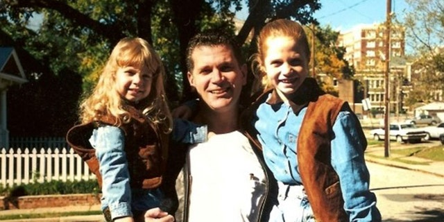 John Battaglia pictured with his two daughters.