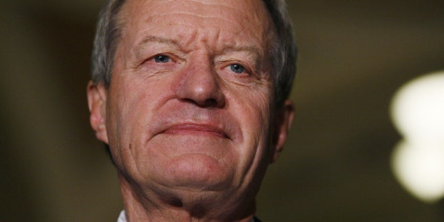 Oct. 15: Senate Finance Committee Chairman Sen. Max Baucus, D-Mont., looks on before speaking to reporters about health care reform legislation. (AP)