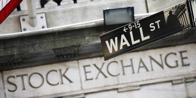 FILE - This July 16, 2013 file photo shows a Wall Street street sign outside the New York Stock Exchange in New York. U.S. stock indexes edged lower in early trading Thursday, Feb. 26, 2015 as investors weighed new economic data on unemployment benefit claims, consumer prices and orders for long-lasting manufactured goods. Oil prices resumed their recent slide. (AP Photo/Mark Lennihan, File)