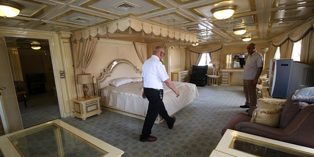 """A captain walks inside the yacht called """"Basrah Breeze"""", once owned by former Iraqi president Saddam Hussein, who was toppled in a U.S.-led invasion in 2003, in the southern port of Basra, Iraq May 14, 2018."""