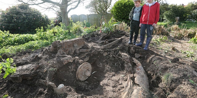 The remains of the car were buried under a rockery.