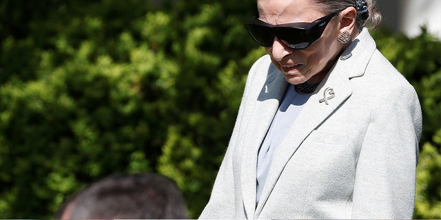 Associate Supreme Court Justice Ruth Bader Ginsburg arrives for the swearing in ceremony of Judge Neil Gorsuch in the Rose Garden of the White House in Washington, U.S., April 10, 2017.